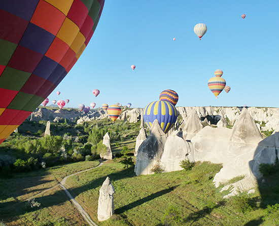 Cappadocia Baloons over fairy chimneys