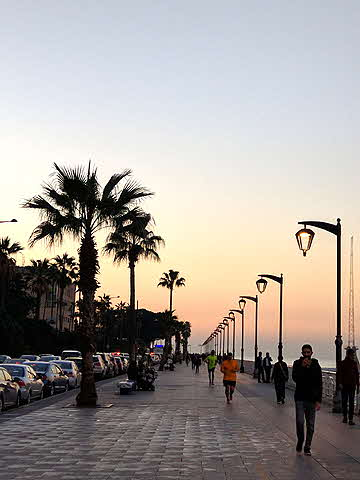 Lebanon strolling Beirut's promenade at sunset