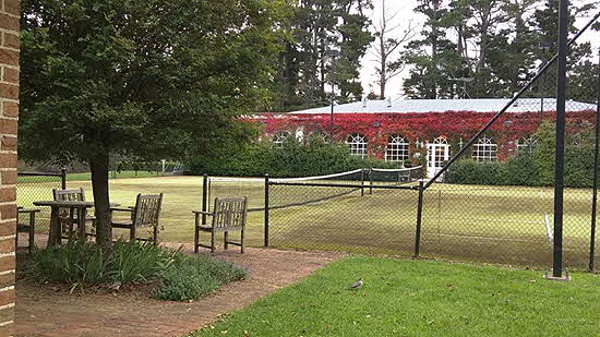 Milton Park grass tennis courts lead to the stately spa