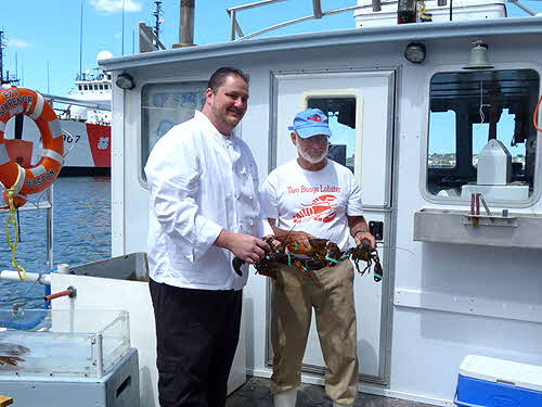 Battery Warf Hotel Chef and Lobsterman with lobsters